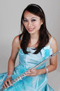 Asian girl with flute. Royalty Free Stock Photo