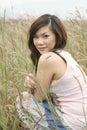 Asian girl among grass Royalty Free Stock Photo