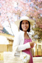 ASIAN GIRL WITH HANDBAG IN THE COUNTRYSIDE Royalty Free Stock Image