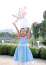 Asian girl happy getting toy park Royalty Free Stock Photo