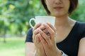 Asian girl hold a cup of coffee with her hand