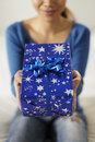 Asian girl holding gift box to the camera Stock Images