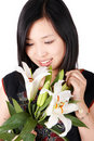 Asian girl holding lily Royalty Free Stock Image