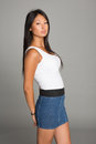 Asian girl in jeans skirt Royalty Free Stock Photo