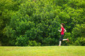 Asian girl jogging at outdoor park Royalty Free Stock Image