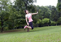 Asian girl jumps Stock Photography