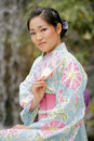 Asian Girl in A Komona Royalty Free Stock Photography