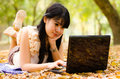 Asian girl with laptop Royalty Free Stock Photography