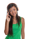 Asian girl likes music young listens to the on a white background Stock Image