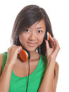 Asian girl listening to the headphone