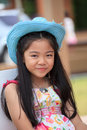 Asian girl with long hair wearing blue cowboy hat Royalty Free Stock Photos