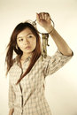 Asian girl with old brass keys looking at a set of Royalty Free Stock Photo