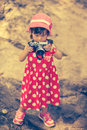 Asian girl photographer with professional digital camera in beau Royalty Free Stock Photo