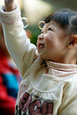 Asian girl playing the Soap bubble Royalty Free Stock Image