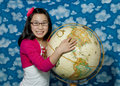 Asian Girl points to a location on a globe Stock Image