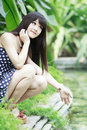 Asian girl in pond edge Royalty Free Stock Image
