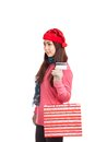 Asian girl with red christmas hat ,credit card and shopping bag Royalty Free Stock Photo