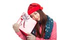 Asian girl with red christmas hat love the gift box isolated on white background Royalty Free Stock Photography