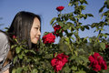 Asian girl with red roses Royalty Free Stock Photos