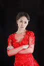 Asian girl in a red transparent dress sitting on the floor and shoes with black hair the studio Stock Photos