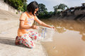 Asian girl release fish into the canal Royalty Free Stock Photo