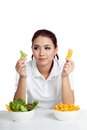 Asian girl with salad and crisps in her hands isolated on white background Royalty Free Stock Image