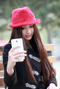 Asian girl self portrait beautiful taking with her smartphone Royalty Free Stock Photo