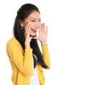 Asian girl shouting young loud hands next to the mouth isolated on white background Royalty Free Stock Images