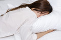 Asian girl sleeping is on a white bed Royalty Free Stock Photo