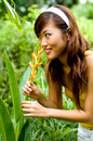 Asian Girl smelling a flower Stock Images