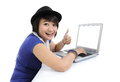 Asian girl smiling and showing thumb up in front of laptop on white background Royalty Free Stock Images