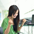Asian girl smiling in success job Stock Photo
