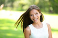 Asian girl spring portrait in park smiling happy mixed race caucasian woman s looking at camera Royalty Free Stock Images