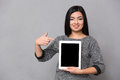 Asian girl staying and pointing on tablet Royalty Free Stock Photo