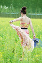 Asian girl strolling in rape field Stock Image