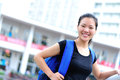 Asian girl student in campus happy smiling Stock Photography