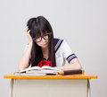 Asian girl student in school study hard uniform  japanese style Royalty Free Stock Photo