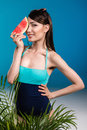 Asian girl in swimsuit holding watermelon piece Royalty Free Stock Photo