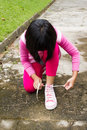 Asian girl tying shoelace young Stock Images
