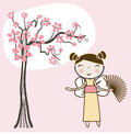 Asian girl under spring floral tree. Royalty Free Stock Photo