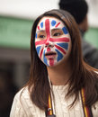 Asian girl with union flag painted on her face Stock Photos