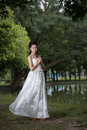 The asian girl in wedding dress in the forest Royalty Free Stock Images