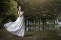 The asian girl in wedding dress in the forest Stock Photography