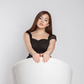 Asian girl in white chair young with black clothes Royalty Free Stock Photos