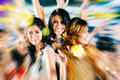 Asian girls partying on dance floor of disco nightclub beautiful friends dancing having fun at fancy night club Stock Photos