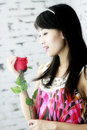Asian girls and roses. Royalty Free Stock Photography