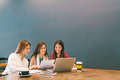 Asian girls using laptop in team business meeting, coworkers or college student, startup project discussion or teamwork brainstorm Royalty Free Stock Photo