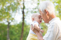 Asian grandfather kissing grandson chinese and relaxing at outdoor Stock Photo