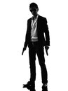 Asian gunman killer standing silhouette one in isolated white background Royalty Free Stock Photos
