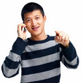 Asian guy calling and pointing at you Stock Image